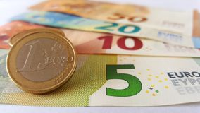Stack of Euro Coins on a Euro Banknotes. Close-up of stack of Euro coins on top of some Euro banknotes stock photography