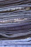 Close up stack of folded jeans vertical Royalty Free Stock Images