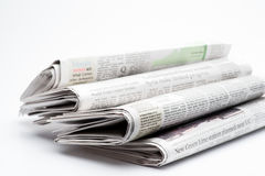 Close up of a stack of  folded newspapers Stock Images