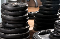 Close-up stack of metal barbells disks in gym Stock Images