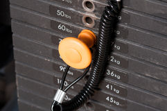 Close-up of stack metal weights in gym equipment Stock Photography