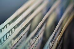 Close up of stack one hundred dollar bills stock photos