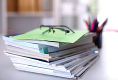 Close up of stack of papers on white background Royalty Free Stock Images