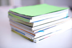 Close up of stack of papers on white background Stock Photo