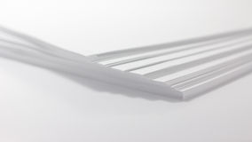 Close up of stack of papers on white background Royalty Free Stock Photo