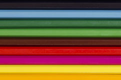 Close up of a stack of pencil crayons horizontal Stock Photo