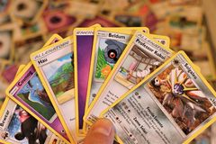 Close up of a stack of Pokemon cards.