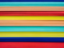 Close up stack of rainbow colored papers for creative work. royalty free stock image
