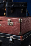 Close-up of a stack vintage shabby suitcases stock photos