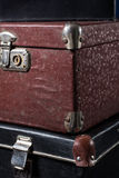 Close-up of a stack vintage shabby suitcases Stock Photo