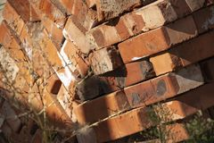 Close up of stacked red clay bricks. Stock Photo