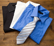 Close up of stacked shirts with tie. Stock Photo