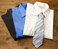 Close up of stacked shirts with tie. Stock Image