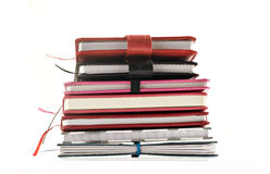 Close up of stacked up books on a white background stock image