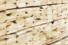 Close up stacked wood planks at sawmill for biomass fuel. Uk royalty free stock photo
