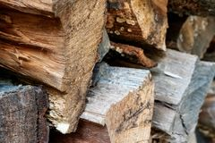 Close Up of Stacked Wooden Logs Background stock image