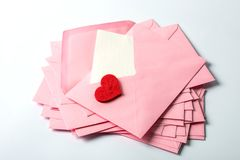 Close up Stacking of pink envelopes and mail letter paper and th Stock Image