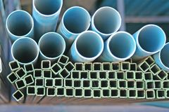Stacks blue circle pipes and square steel with hollow royalty free stock photography