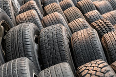 Close up stacks of old used tires. For sale Stock Images