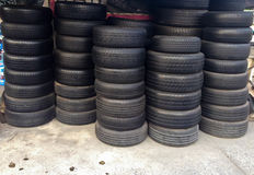 Close up stacks of old used tires for sale Royalty Free Stock Photography