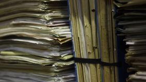 Close up of stacks of paper in the archive stock video footage