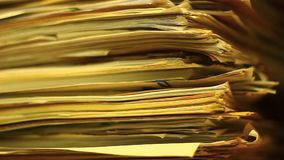 Close up of stacks of paper in the archive stock video