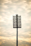 Close up of stadium lights in warm tone Stock Images