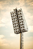 Close up of stadium lights in warm tone Royalty Free Stock Image