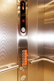 Close up of stainless steel elevator panel push buttons. Stock Images