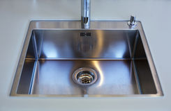 Close up of stainless steel kitchen sink Royalty Free Stock Images