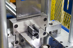 Close up Stainless Steel sheet metal exiting roll forming machine. / Intermarch 2017 Industrial Machinery Exhibition at Bitech Thailand - May 2017 stock photography