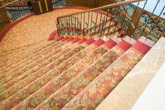 Close up of Staircase covered with carpet . Royalty Free Stock Photos