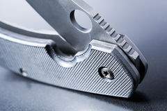Close Up Of A Standing Half Opened Faint Military Knife On Dark Ground Stock Photography