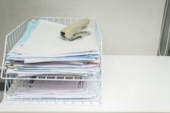 Stapler on business document piles to be in order. Close up stapler on business document piles to be in order stock images