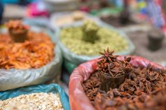 Close-up star anise and other spices on indian market. Stall stock photos