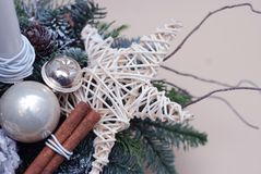 Close up a Star Decorated Christmas tree Fir Branch Arrangement or Copmosition with Cinnamon Sticks and Silver Baubble Stock Photography