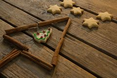 Close up of star shape cookies by Christmas tree made with cinnamon stick Stock Images