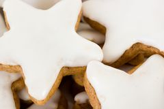 Close up of star-shaped cinnamon biscuits Royalty Free Stock Photo