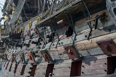 Close Up of the Starboard Side of an Ancient Pirate Galeon with. The Hatches of the Cannons Open on Blur Background stock photos
