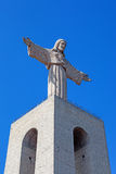 Close-up of the statue of Christ placed on top of the Cristo-Rei or King-Christ Sanctuary in Almada. Stock Photo
