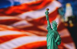 CLOSE UP OF STATUE OF LIBERTY WITH BLUR AMERICAN FLAG. In the New York City, independence, day, memorial, usa, freedom, immigration, symbol, patriotism royalty free stock photos