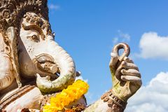 Close-up statute of Ganesha outdoor against blue sky and white c Stock Images