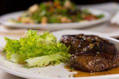 Close Up of Steak on Plate with Garnish Royalty Free Stock Image