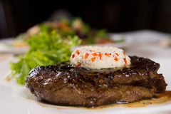 Close Up of Steak Topped with Herbed Butter Stock Photography