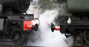 Didcot Railway Centre. Close up of steam emitting between locomotives at Didcot Railway Centre. A working heritage rail museum Based around the original Great royalty free stock image