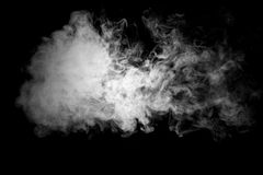Close up of steam smoke on black background stock images