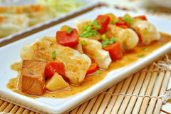 Close up steamed stuffing flour wrap pork topped yellow curry. Stock Photos
