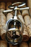 Corkscrew on corks in close-up royalty free stock image