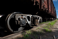 Close-up Steel diesel railcar train bogie wheels on the tracks Royalty Free Stock Photos