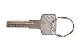 Close up of steel key with ring. Royalty Free Stock Photo